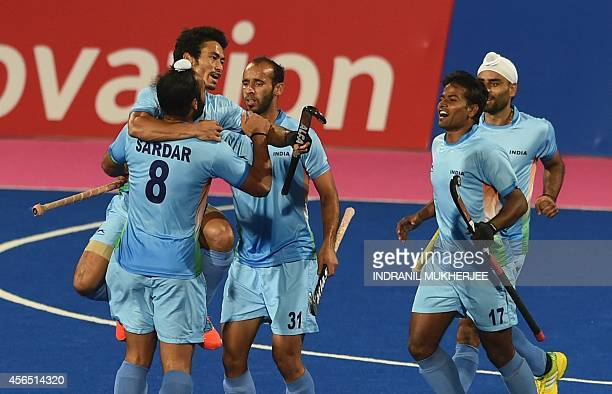 India's Kothajit Singh celebrates with teammates after a goal during the men's hockey final match of the 2014 Asian Games between India and Pakistan...
