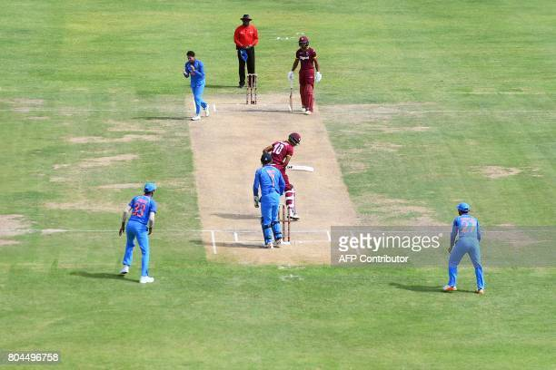 India's Kuldeep Yadav celebrates after bowling out West Indies' Roston Chase during the third One Day International match between West Indies and...