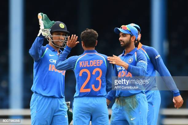 India's Kuldeep Yadav celebrates with teammate after dismissing West Indies' Evin Lewis during the second One Day International match between West...