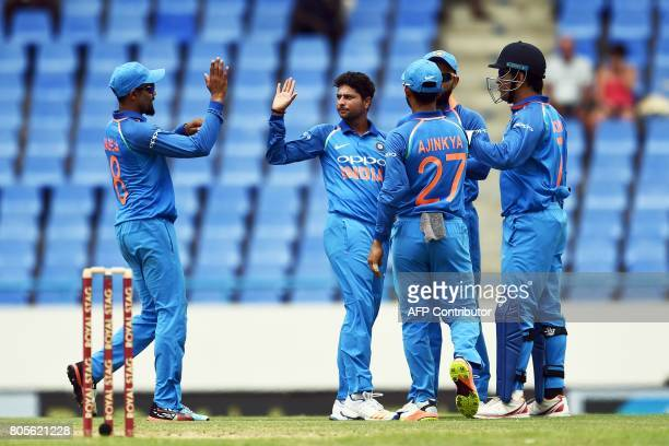 India's Kuldeep Yadav celebrates with teammates after dismissing West Indies' Evin Lewis during the fourth One Day International match between West...