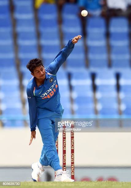 India's Kuldeep Yadav delivers a ball during the fourth One Day International match between West Indies and India at the Sir Vivian Richards Cricket...