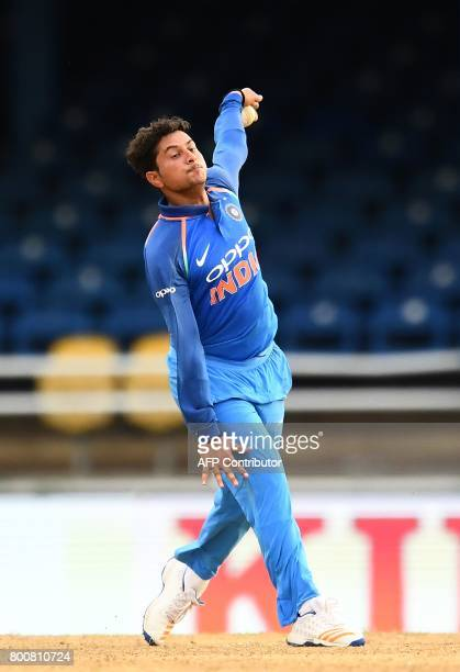 India's Kuldeep Yadav delivers a ball during the second One Day International match between West Indies and India at the Queen's Park Oval in Port of...