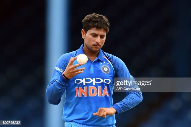 India's Kuldeep Yadav prepares to deliver a ball during the second One Day International match between West Indies and India at the Queen's Park Oval...
