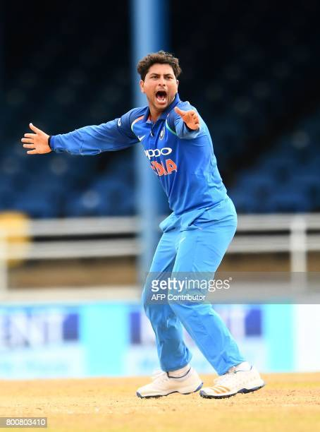 India's Kuldeep Yadav successfully appeals for LBW against West Indies' Shai Hope during the second One Day International match between West Indies...