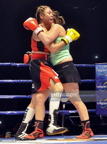 India's Laishram Sarita Devi fights against Hungarys Zsofia Bedo during their IBC Pro Boxing match on January 29 2017 at the Khuman Lampak Indoor...