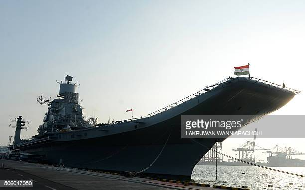 Indias largest naval ship the INS Vikramaditya anchors in the Sri Lankan capital Colombo on January 21 as she sails from her home base in the western...