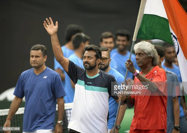 India's Leander Peas gestures towards crowd as he celebrates after Ramkumar Ramanathan won the Davis Cup singles tennis match against New Zealand's...