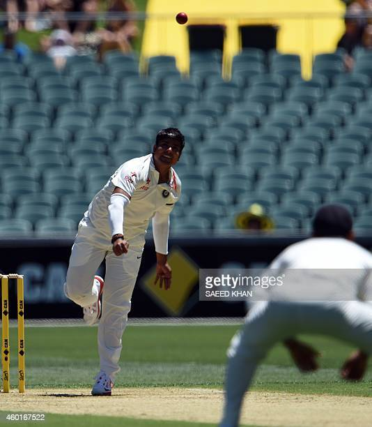 India's legspinner bowler Karn Sharma bowls at his Test cricket debut against on the first day of the the first Test match between Australia and...