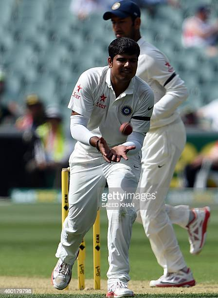 India's legspinner bowler Karn Sharma gets ready to bowl on the first day of the first Test match between Australia and India at Adelaide Oval in...