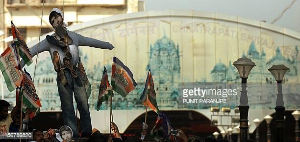 India's Maharashtra Navnirman Sena activists hang an effigy of Pakistanborn Mohammed Kasab who was the sole surviving gunman of the 2008 Mumbai...