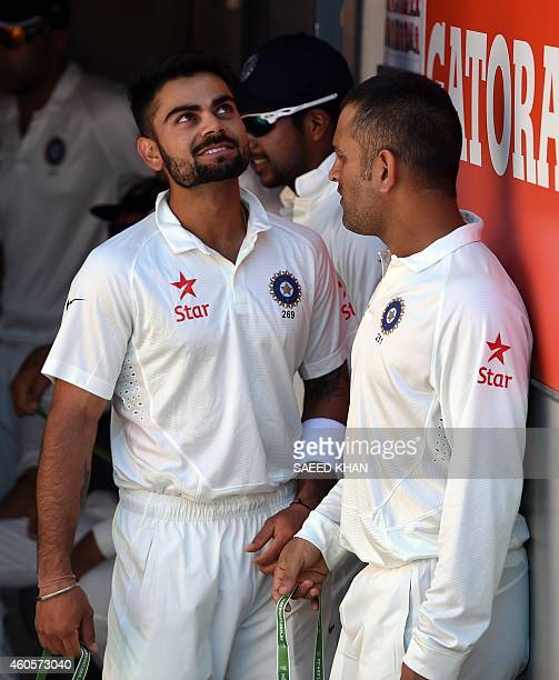 India's Mahendra Singh Dhoni and Virat Kohli talk prior to day one of the 2nd cricket Test match between Australia and India at The Gabba in Brisbane...