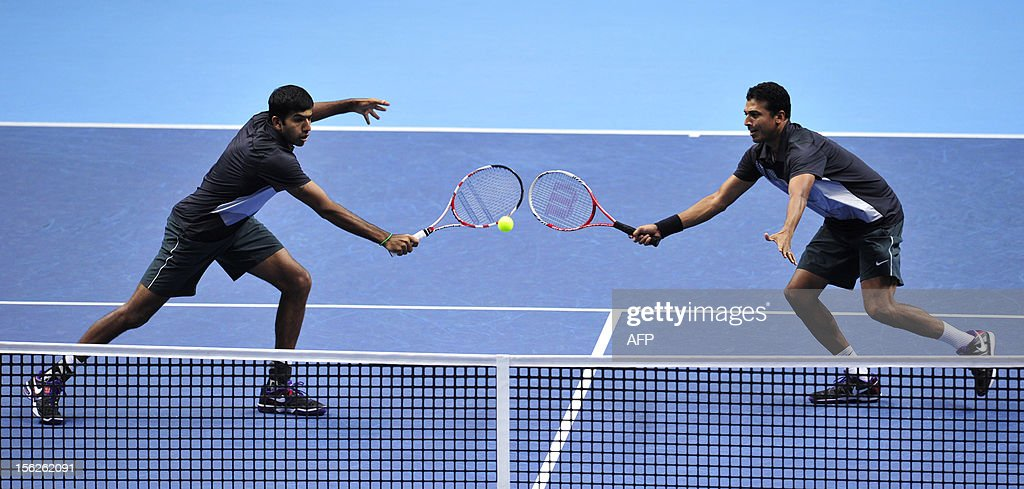 India's Mahesh Bhupathi (R) and India's Rohan Bopanna (L) reach for the same ball against Spain's Marcel Granollers and Spain's Marc Lopez during the doubles final on the eighth day of the ATP World Tour Finals tennis tournament in London on November 12, 2012.
