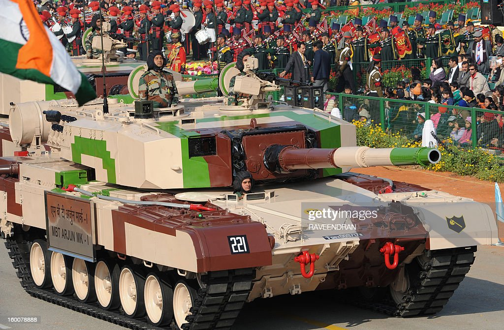 India's main battle tank 'Arjun' rolls down the ceremonial boulevard Rajpath during the Republic Day parade in New Delhi on January 26, 2013. India marked its Republic Day with celebrations held under heavy security, especially in New Delhi where large areas were sealed off for an annual parade of military hardware at which Bhutan's king Jigme Khesar Namgyel Wangchuck was chief guest.