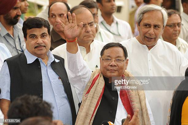 India's main opposition Bharat Janata Party ledNational Democratic Alliance Presidential candidate P A Sangma waves as BJP president Nitin Gadkari...