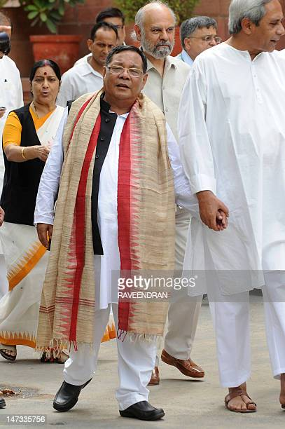 India's main opposition Bharat Janata Party ledNational Democratic Alliance Presidential candidate P A Sangma walks with Orissa Chief Minister Naveen...