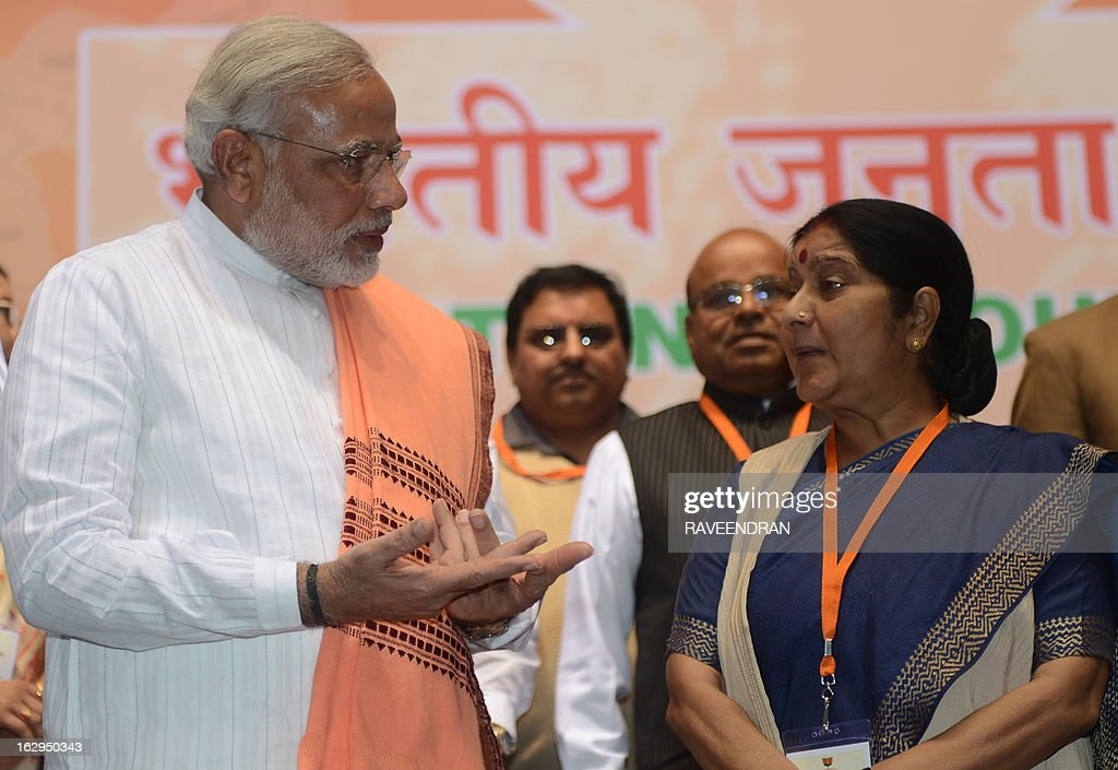 India's main opposition Bharatiya Janata Party (BJP) leader and Chief Minister of Gujarat, Narendra Modi (L) talks with Indian opposition leader Sushma Swaraj during a BJP National Council two day meeting in New Delhi on March 2, 2013. Amid calls for a larger role for him Modi won singular praise from BJP President Rajnath Singh for being the 'most popular' chief minister having registered 'never before' three consecutive electoral wins for the party in Gujarat. In a poll published in January, 36 percent of voters surveyed said Modi would make the best prime minister -- well ahead of his likely election rival Rahul Gandhi of the ruling Congress party who had just 22 percent.