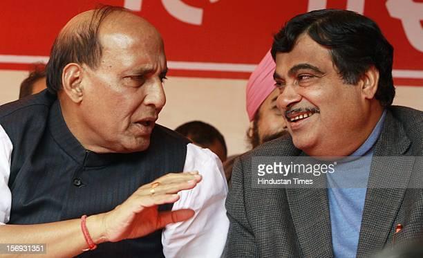 India's main opposition Bharatiya Janata Party President Nitin Gadkari and BJP senior leader and former BJP president Rajnath Singh attend a rally to...