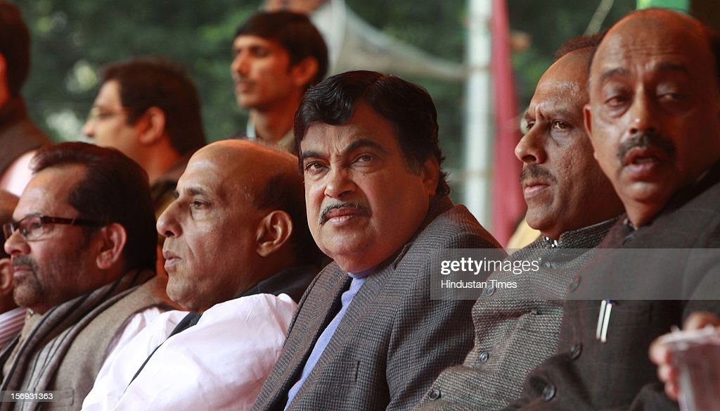 India's main opposition Bharatiya Janata Party (BJP) President Nitin Gadkari (C) and BJP senior leader and former BJP president Rajnath Singh, Mukhtar Abbas Naqbi and other BJP Leaders attend a rally to protest against Foreign Direct Investment (FDI) on November 21, 2012 in New Delhi, India. The party has decided to oppose the government's decision to allow FDI in Multi-brand retail.