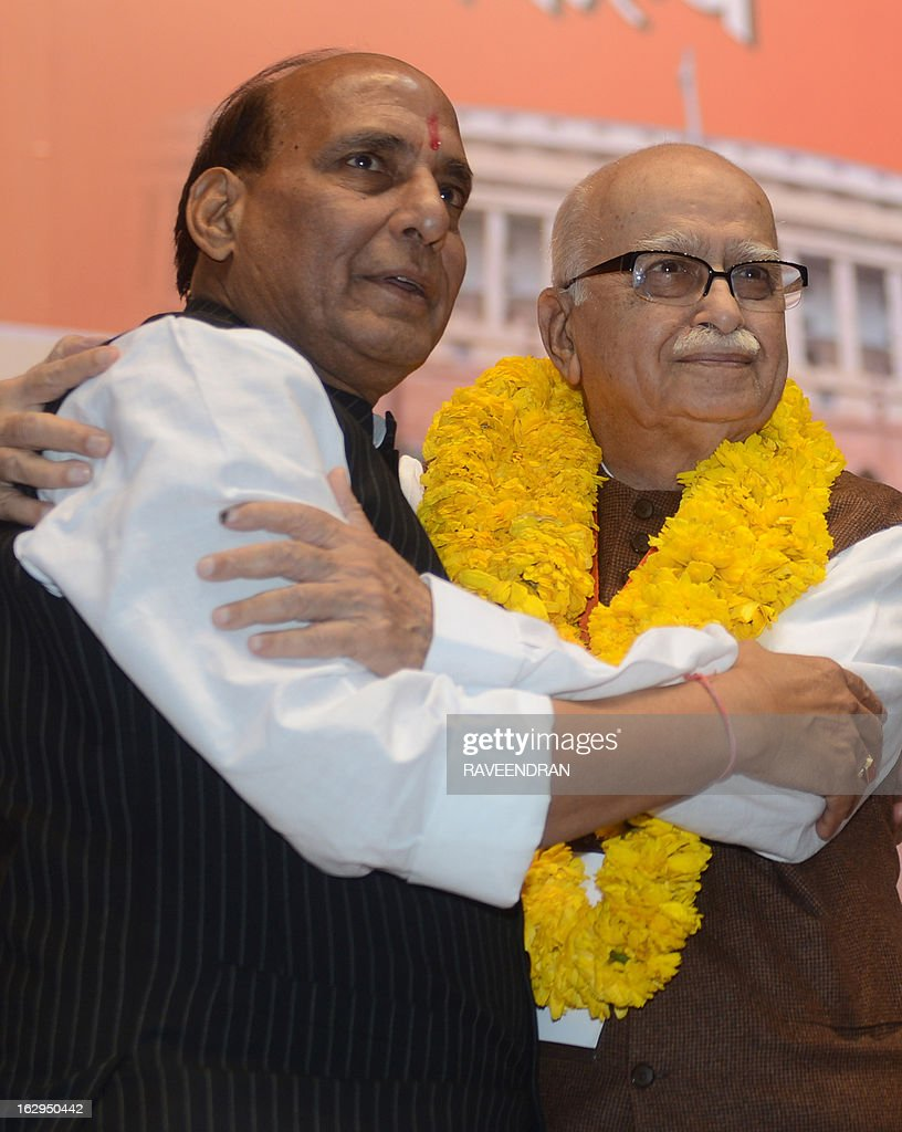 India's main opposition Bharatiya Janata Party (BJP) President Rajnath Singh (L) hugs BJP Senior Leader Lal Krishna during a BJP National Council meeting in New Delhi on March 2, 2013. The two day BJP party meeting was held for the party to deliberate its road map in the run up to the next general elections in 2014, besides discussing the political and economic issues confronting the country.