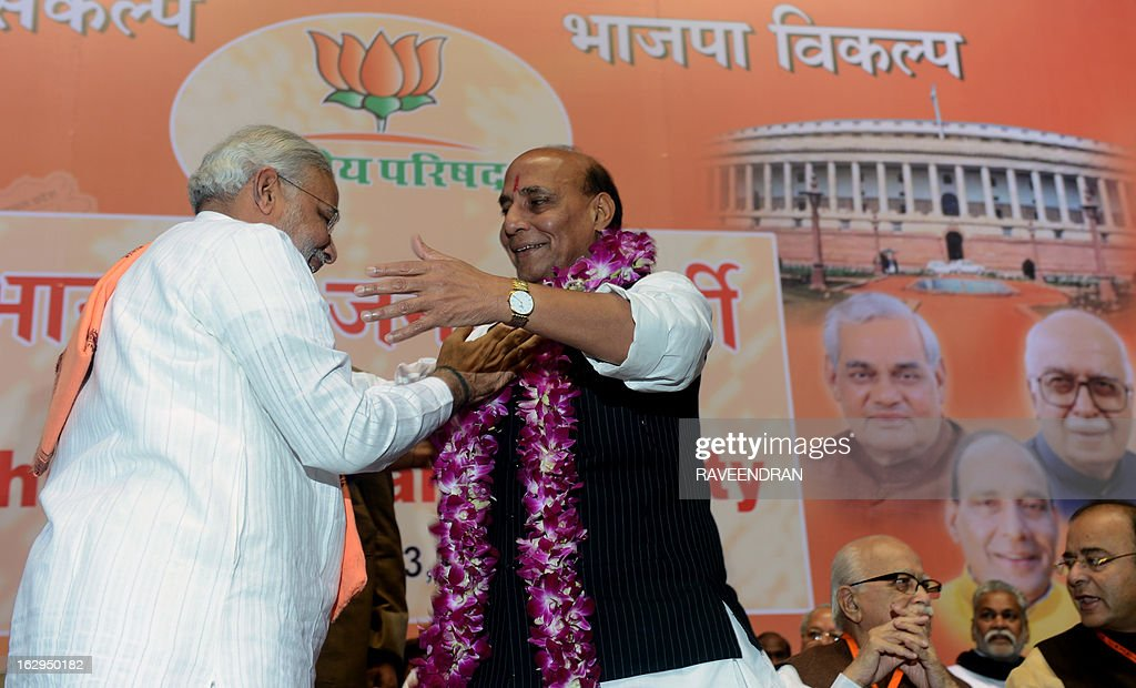 India's main opposition Bharatiya Janata Party (BJP) senior leader and Chief Minister of Gujarat, Narendra Modi (L), gives a garland to BJP President Rajnath Singh during a BJP National Council two day meeting in New Delhi on March 2, 2013. Amid calls for a larger role for him Modi won singular praise from BJP President Singh for being the 'most popular' chief minister having registered 'never before' three consecutive electoral wins for the party in Gujarat. In a poll published in January, 36 percent of voters surveyed said Modi would make the best prime minister -- well ahead of his likely election rival Rahul Gandhi of the ruling Congress party who had just 22 percent.