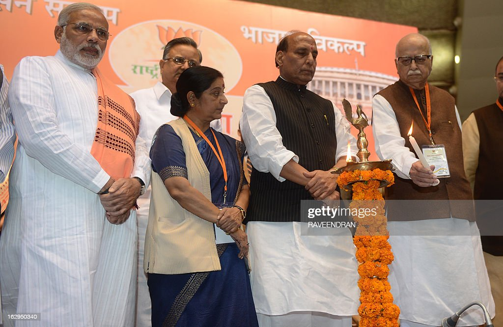 India's main opposition Bharatiya Janata Party (BJP) senior leader Lal Krishna Advani (R) lights a lamp as BJP President Rajnath Singh (2R), Chief Minister of Gujarat, Narendra Modi (L) and Indian opposition leader Sushma Swaraj (2L) look on during a BJP National Council two day meeting in New Delhi on March 2, 2013. Amid calls for a larger role for him Modi won singular praise from BJP President Rajnath Singh for being the 'most popular' chief minister having registered 'never before' three consecutive electoral wins for the party in Gujarat. In a poll published in January, 36 percent of voters surveyed said Modi would make the best prime minister -- well ahead of his likely election rival Rahul Gandhi of the ruling Congress party who had just 22 percent.