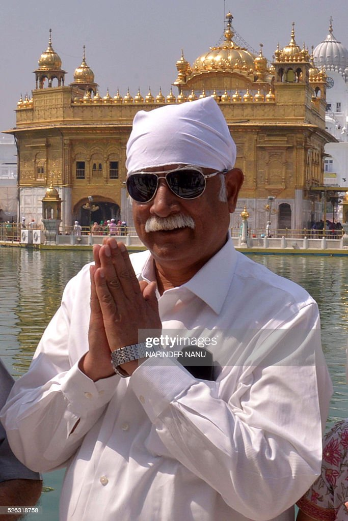 India's Minister for Civil Aviation Ashok Gajapathi Raju poses as he pays his respects at the Sikh Shrine, The Golden Temple in Amritsar on April 30,2016. / AFP / NARINDER