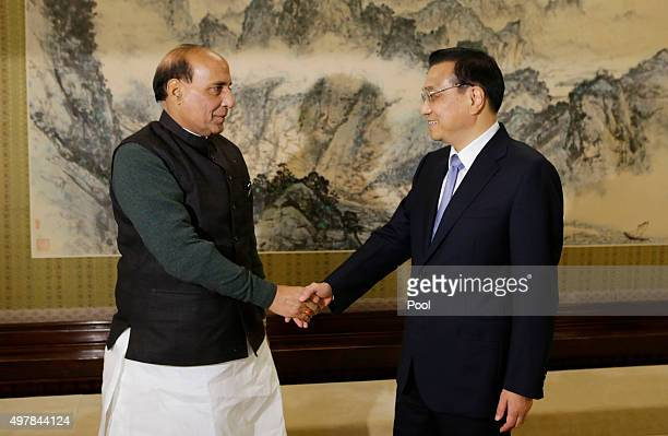 India's Minister of Home Affairs Rajnath Singh shakes hands with China's Premier Li Keqiang during a meeting at the Zhongnanhai Leadership Compound...