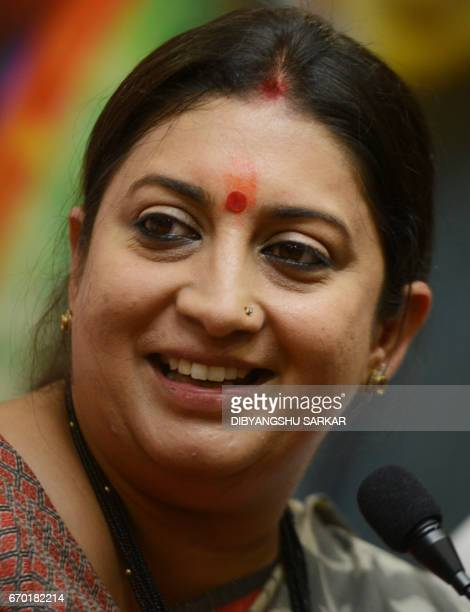 India's Minister of Human Resource Development Smriti Irani looks on as she attends a conference at the Bharatiya Janata Party state office in...