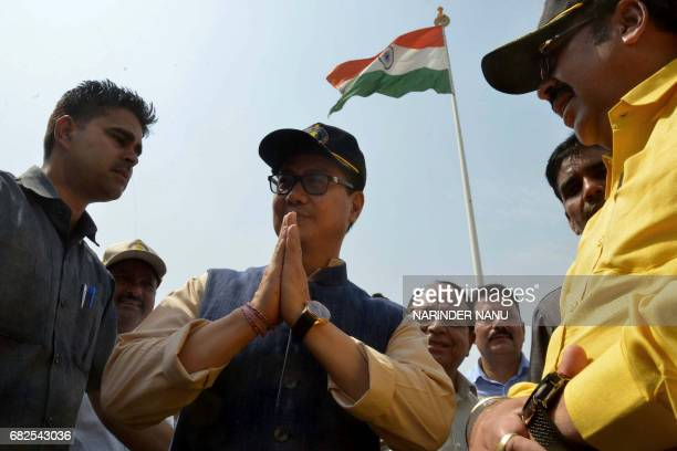 India's Minister of State for Home Affairs Kiren Rijiju gestures after unfurling a giant national tricolour flag on a 107 foot flagpole at The...