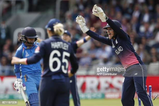 India's Mithali Raj is run out by England's Sarah Taylor during the ICC Women's World Cup cricket final between England and India at Lord's cricket...