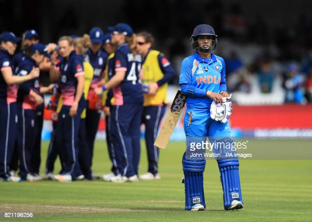 India's Mithali Raj walks off after being run out during the ICC Women's World Cup Final at Lord's London