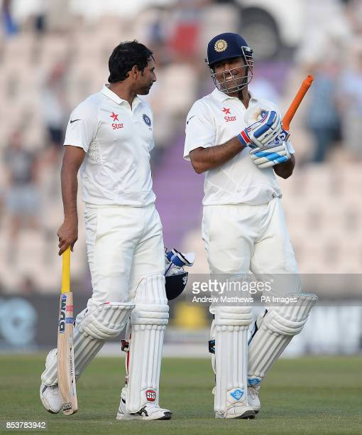 India's Mohammed Shami and MS Dhoni walk off the field of play after day three of the Third Investec Test match at the Ageas Bowl Southampton