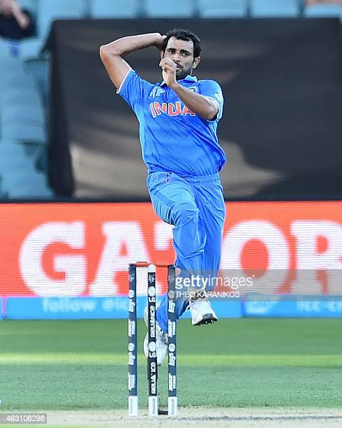 India's Mohammed Shami bowls during the oneday international World Cup warmup cricket match between India and Afghanistan in Adelaide on February 10...