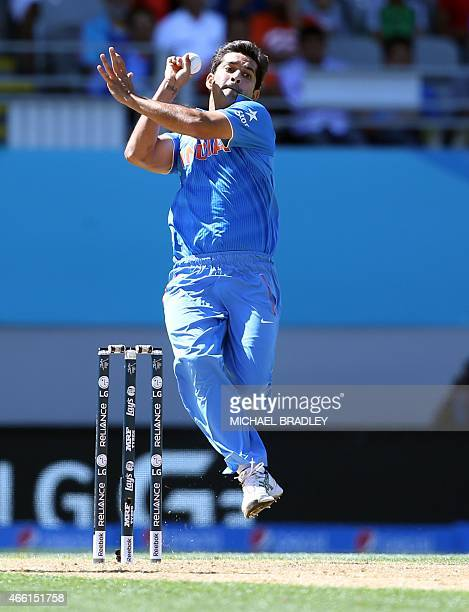 India's Mohammed Shami bowls during the Pool B Cricket World Cup match between India and Zimbabwe at Eden Park in Auckland on March 14 2015 AFP PHOTO...