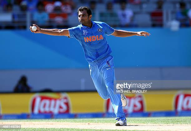India's Mohammed Shami catches the ball during the Pool B Cricket World Cup match between India and Zimbabwe at Eden Park in Auckland on March 14...