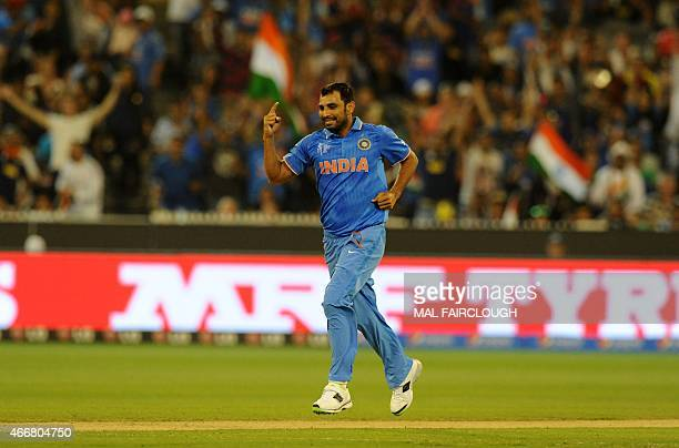 India's Mohammed Shami celebrates taking the wicket during the 2015 Cricket World Cup quarterfinal match between India and Bangladesh at the...