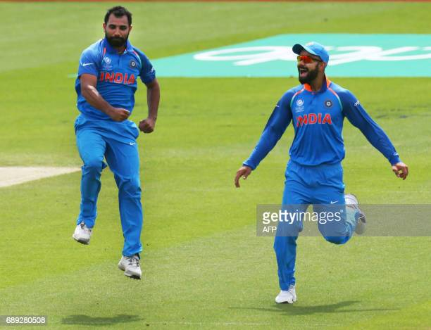 India's Mohammed Shami celebrates the wicket of New Zealand's Neil Broom ith India's captain Virat Kohli during the ICC Champions Trophy Warmup match...