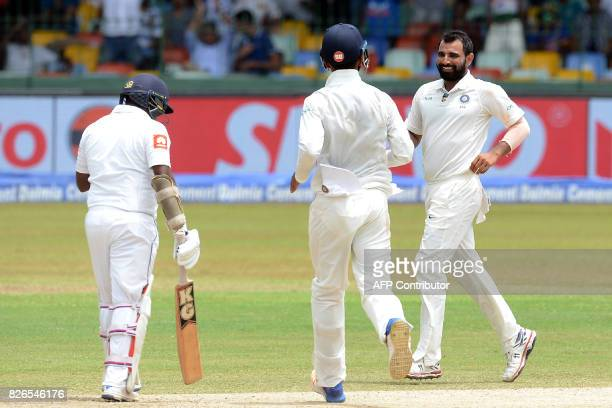 India's Mohammed Shami celebrates with his teammates after he dismissed Sri Lanka's Rangana Herath during the third day of the second Test cricket...