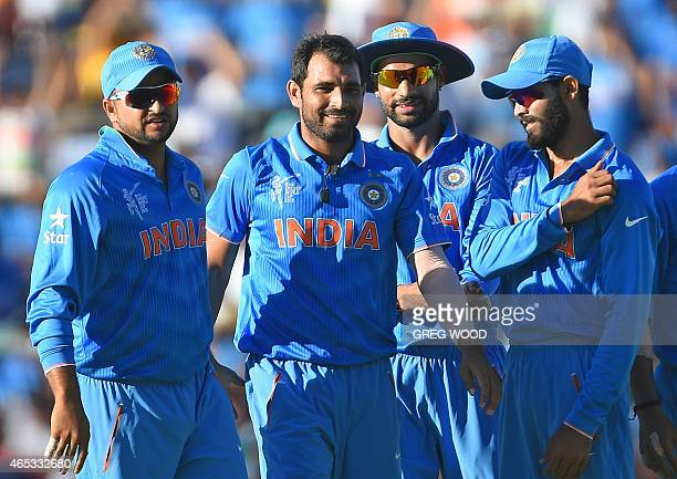 India's Mohammed Shami celebrates with teammates after taking the wicket of West Indies batsman Darren Sammy during the 2015 Cricket World Cup Pool B...