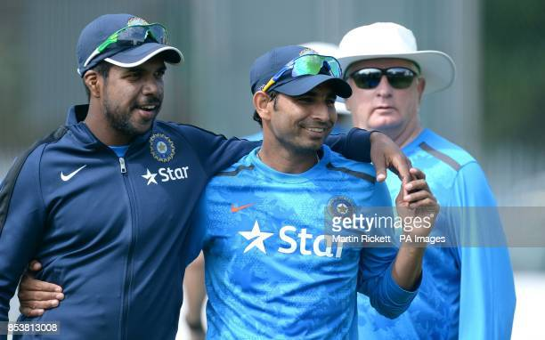India's Mohammed Shami is watched by coach Duncan Fletcher during a nets practice session at Emirates Old Trafford Manchester