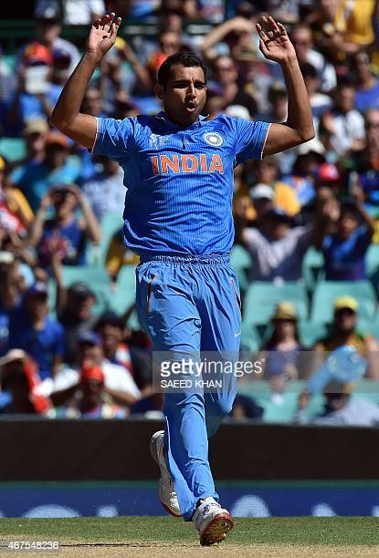 India's Mohammed Shami reacts after bowling a delivery to Australia's Aaron Finch during the 2015 Cricket World Cup semifinal match at the Sydney...