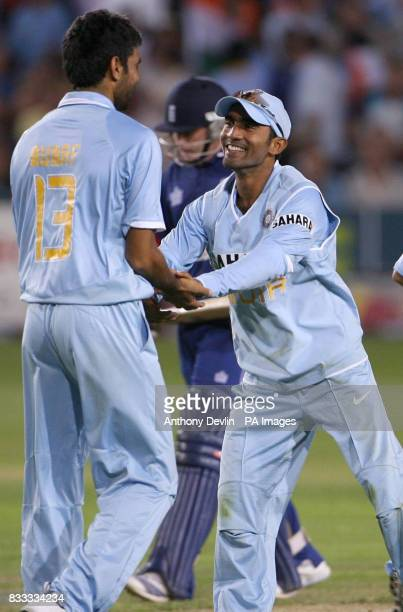 India's Munaf Patel and Dinesh Karthik celebrate as Ian Bell is caught by Patel bowled Piyush Chawla for 64 runs during the NatWest Series match at...