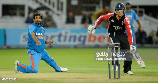 India's Munaf Patel runs out England batsman Graeme Swann during the fourth oneday international cricket match against India at Lord's cricket ground...