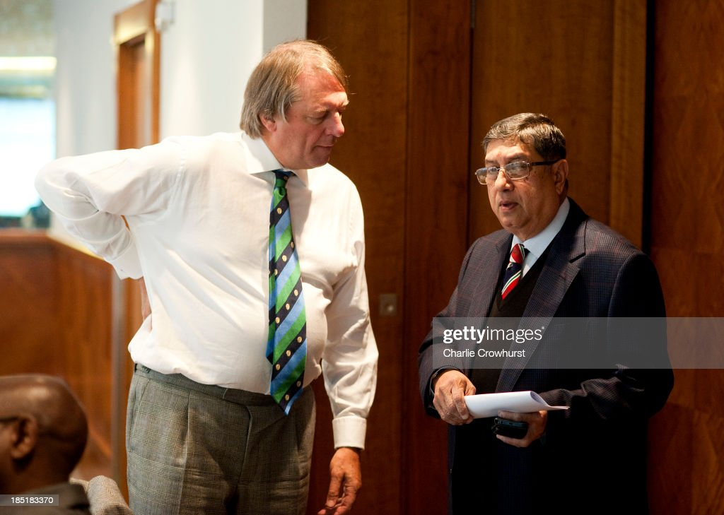 India's N Srinivasan chats to Giles Clarke during the ICC Board Meeting at The Royal Garden Hotel on October 18, 2013 in London, England.