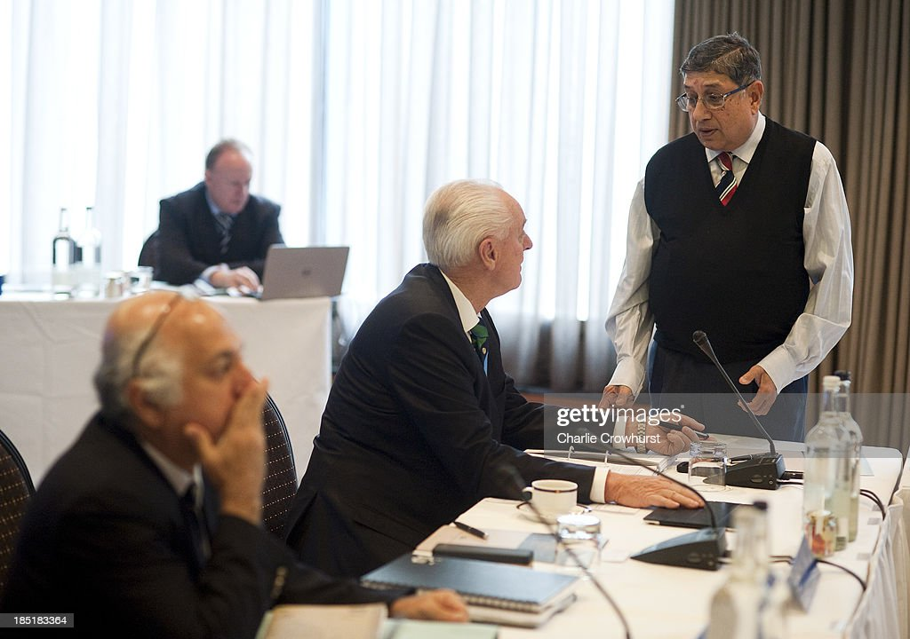 India's N Srinivasan chats to Wally Edwards of Australia during the ICC Board Meeting at The Royal Garden Hotel on October 18, 2013 in London, England.
