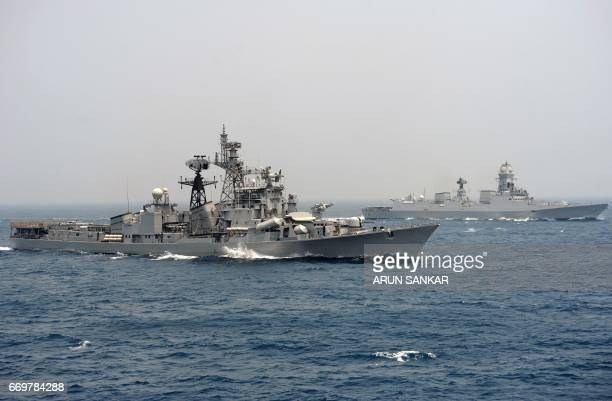 India's naval ship INS Ranvir along with the INS Chennai take part in an exercise drill in the Bay Of Bengal off the coast of Chennai on April 18...