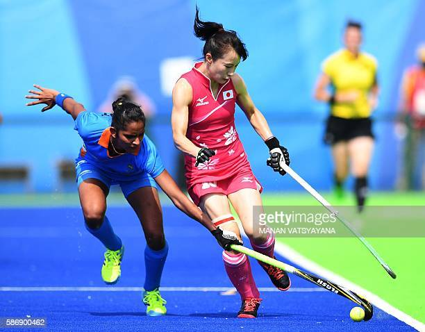 India's Navjot Kaur vies for the ball with Japan's Mie Nakashima during the women's field hockey Japan vs India match of the Rio 2016 Olympics Games...