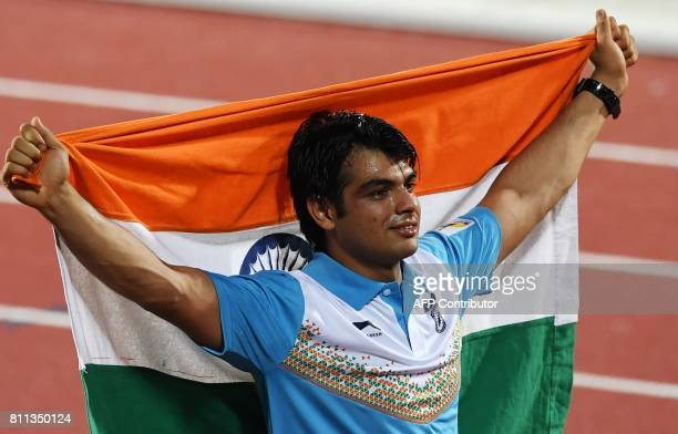 India's Neeraj Chopra celebrates placing first in the javelin throw event during the final day of the 22nd Asian Athletics Championships on July 9...