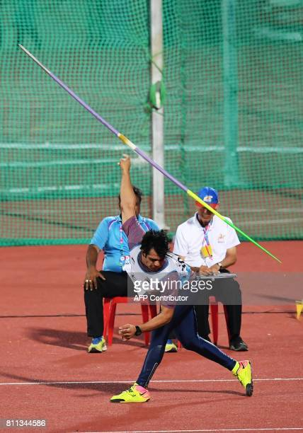 India's Neeraj Chopra competes during the javelin throw during the final day of the 22nd Asian Athletics Championships on July 9 2017 at Kalinga...