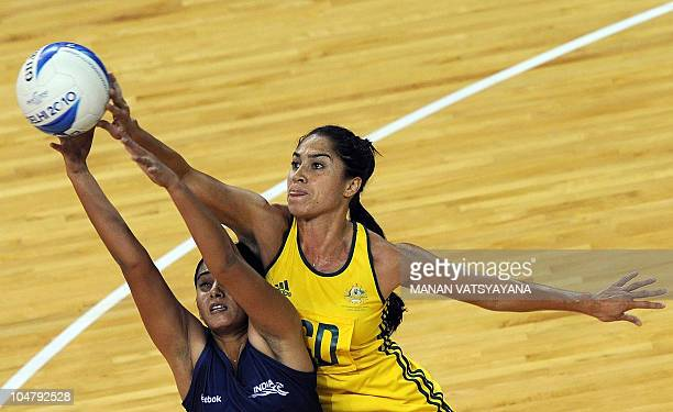India's Neha Kansal vies for the ball with Australia's Mo'onia Gerrard during a women's group match in the XIX Commonwealth Games at the Thyagaraj...